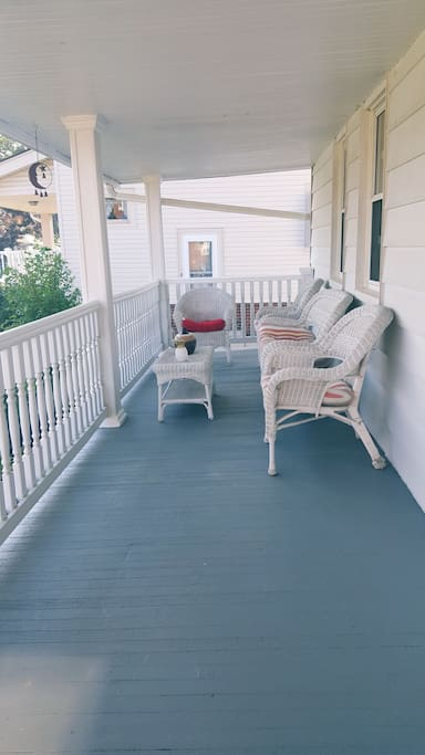 Brightly upholstered wicker furniture add a cozy element to the already cute front porch. The perfect place to enjoy your complimentary coffee and/or breakfast!