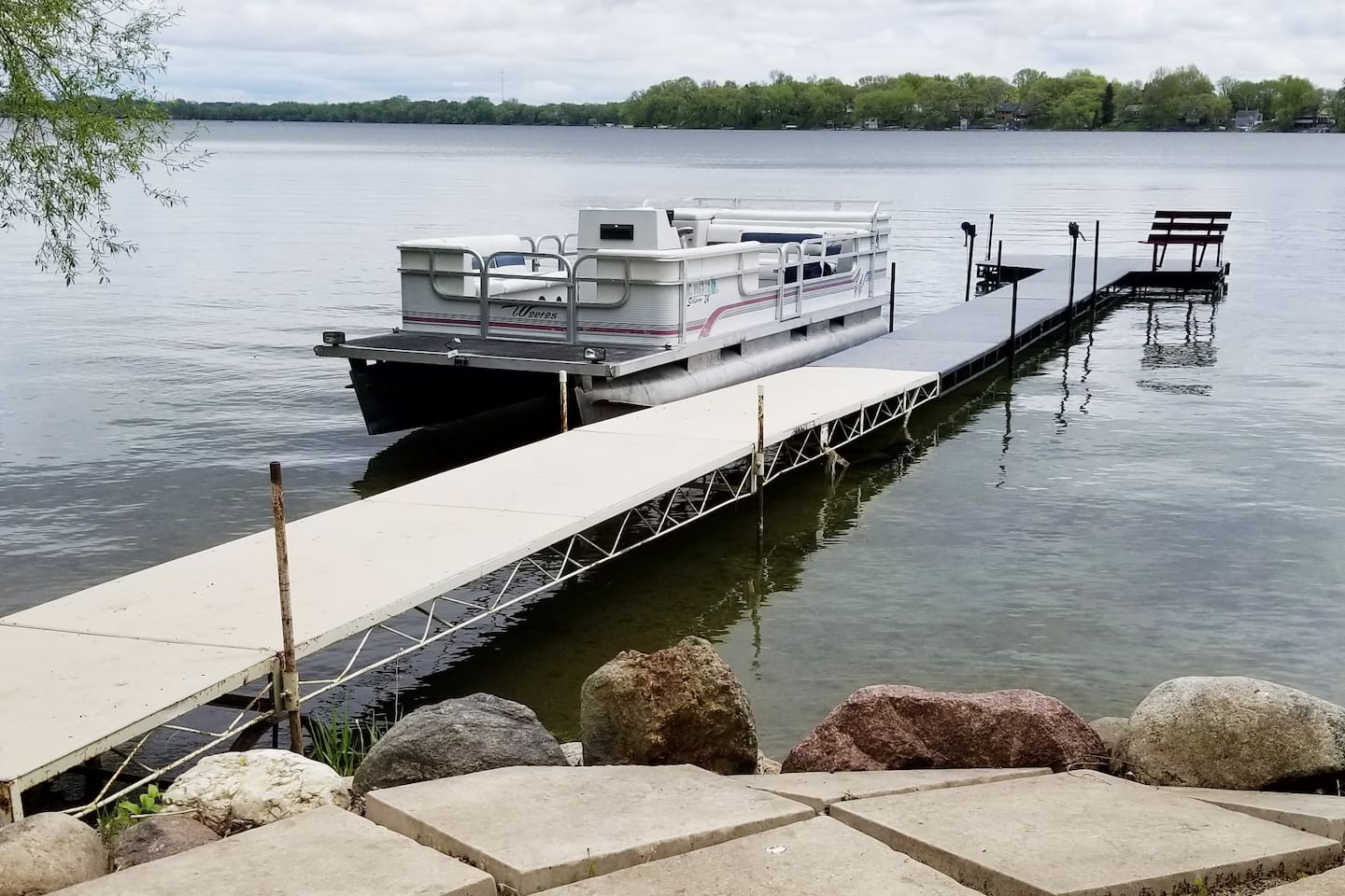 Dock . . . Pontoon is not included in the nightly price; however, feel free to use it as a sun deck next to the dock. (The winter ice heaved our patio a bit. We will be making repairs soon.)