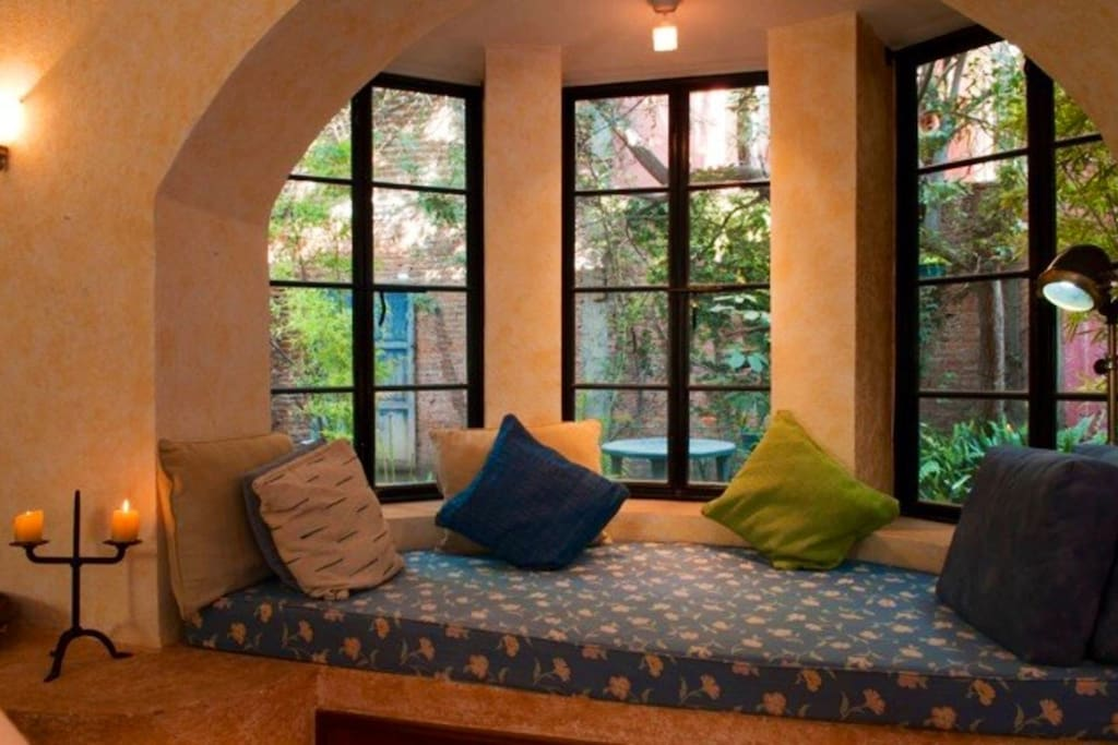 Window seat living room can be used as bed for overflow