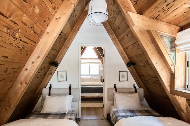 Loft with two twin beds sleeps two guests. Adaptive foam mattress, luxurious linens, and Pendleton wool blankets.