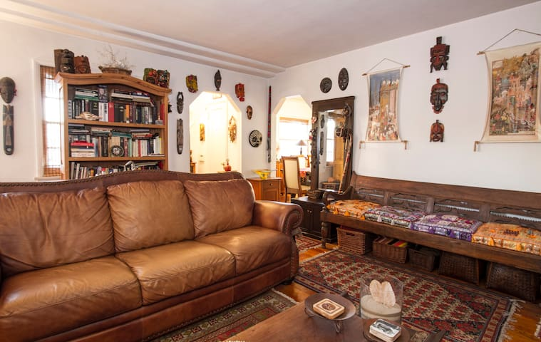Living room. Extra blankets and pillows available if you want to feel extra comfy or nap on the leather couch.