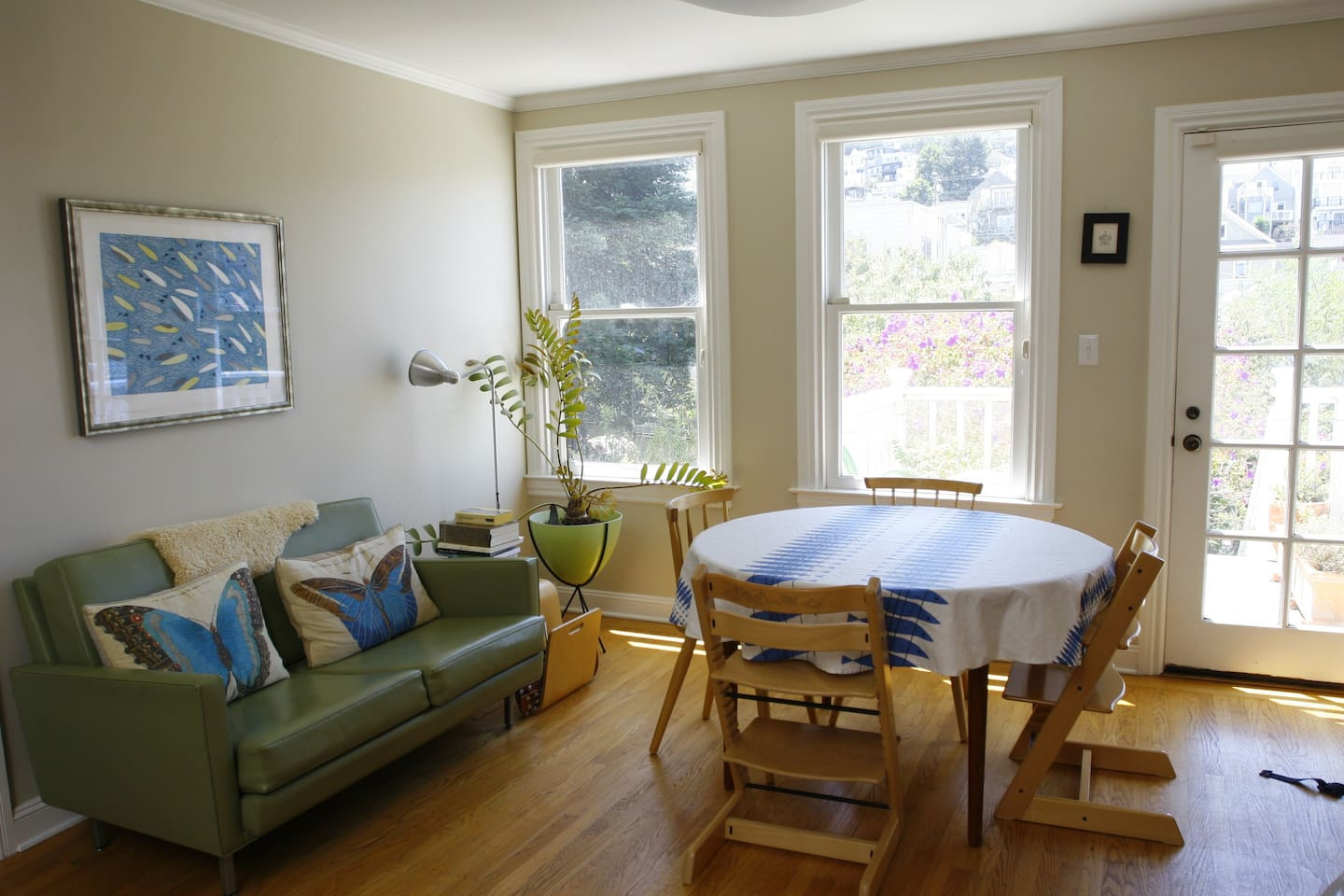 The house features a bright open kitchen and dining area. This is the dining side, with windows to the garden.