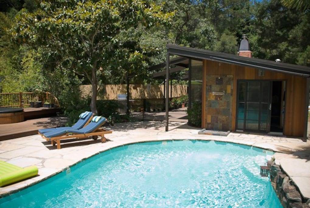 Comfy chase lounges and an outdoor shower