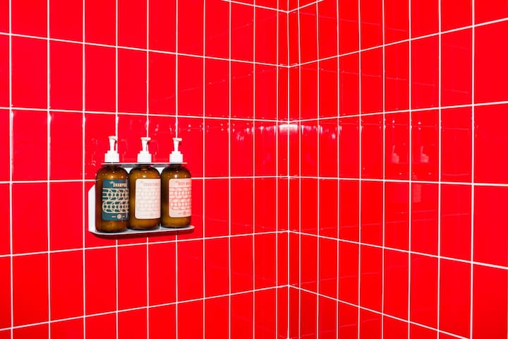 Vibrant red tile in the shower!