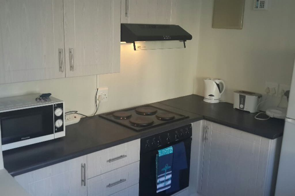 Brand new oven-hob  and microwave with kettle and toaster and sandwich machine