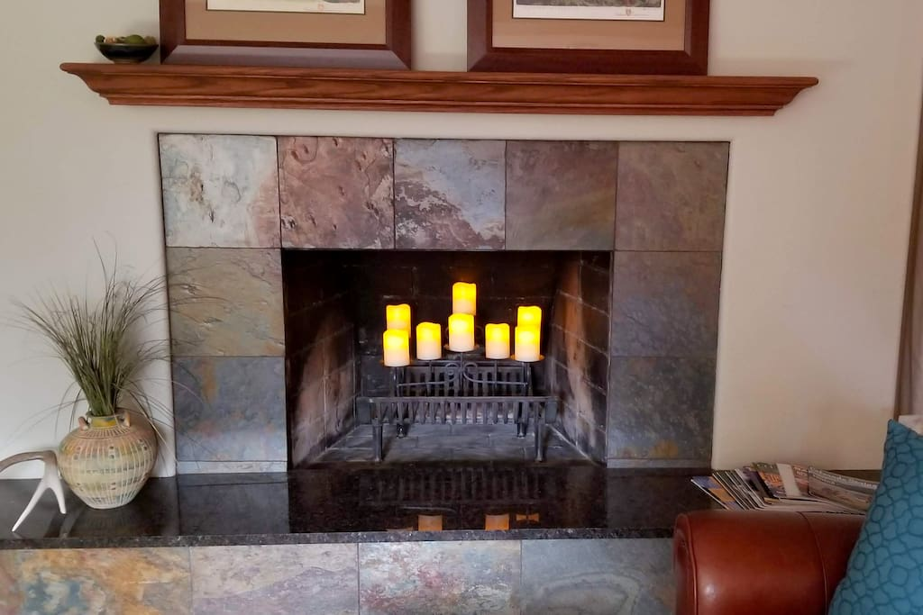 Beautiful fireplace with relaxing electric candelabra.