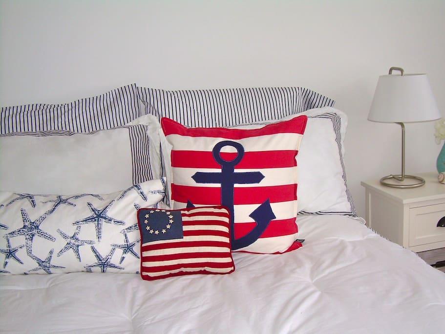 Sweet dreams in this inviting crisp white designer bedroom.