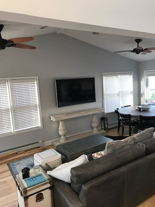 Living room with 4k Apple TV (Includes Netflix, HBO, Starz, Showtime and more)