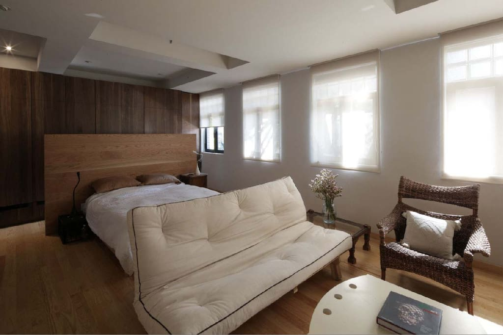 huge room with the bed and the living