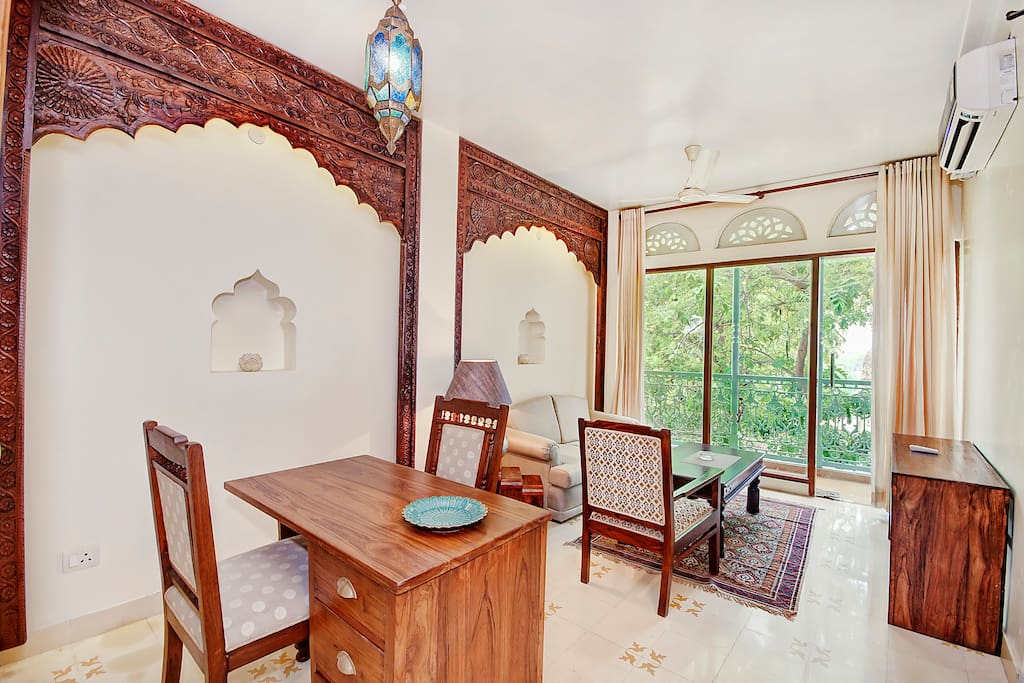 Drawing Room. Uncluttered ,Simple and reflecting the old Rajasthani Style Interiors. It has a view of Pond and Monument.