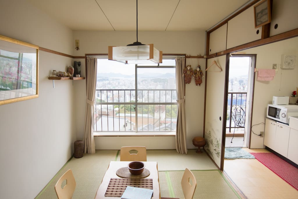 front left tatami room, with the kitchen on the left. amazing views over Hiroshima. After this photo was taken we put in a air conditioner (both hot and cold possible) on the wall, above the Burmese dolls. Warm in winter and cool in summer.
