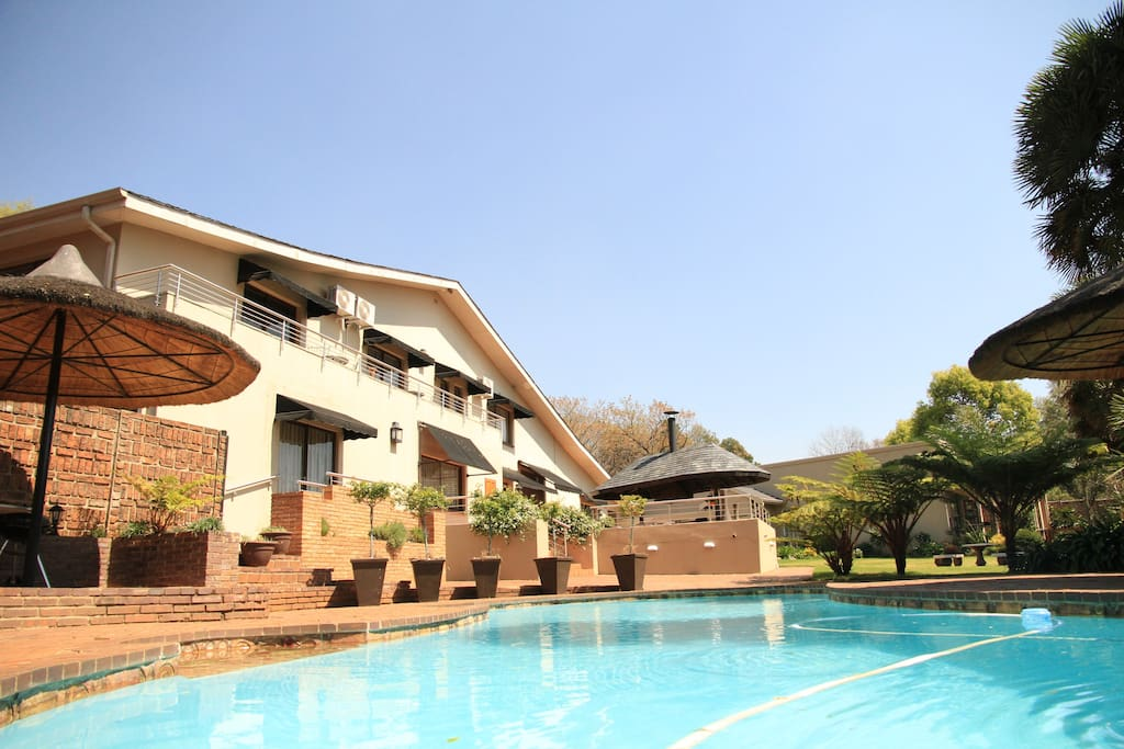 General view of Guest House and the swimming pool.