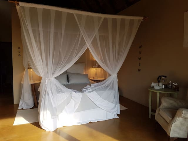 Spacious Queen sized bed with mosquito net