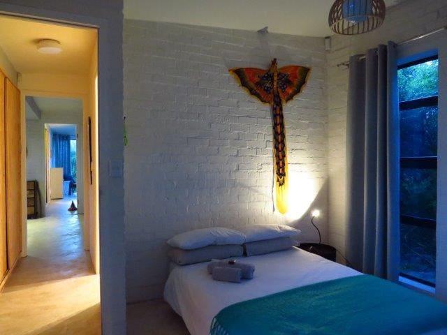 Second bedroom with glass sliding door onto wooden deck