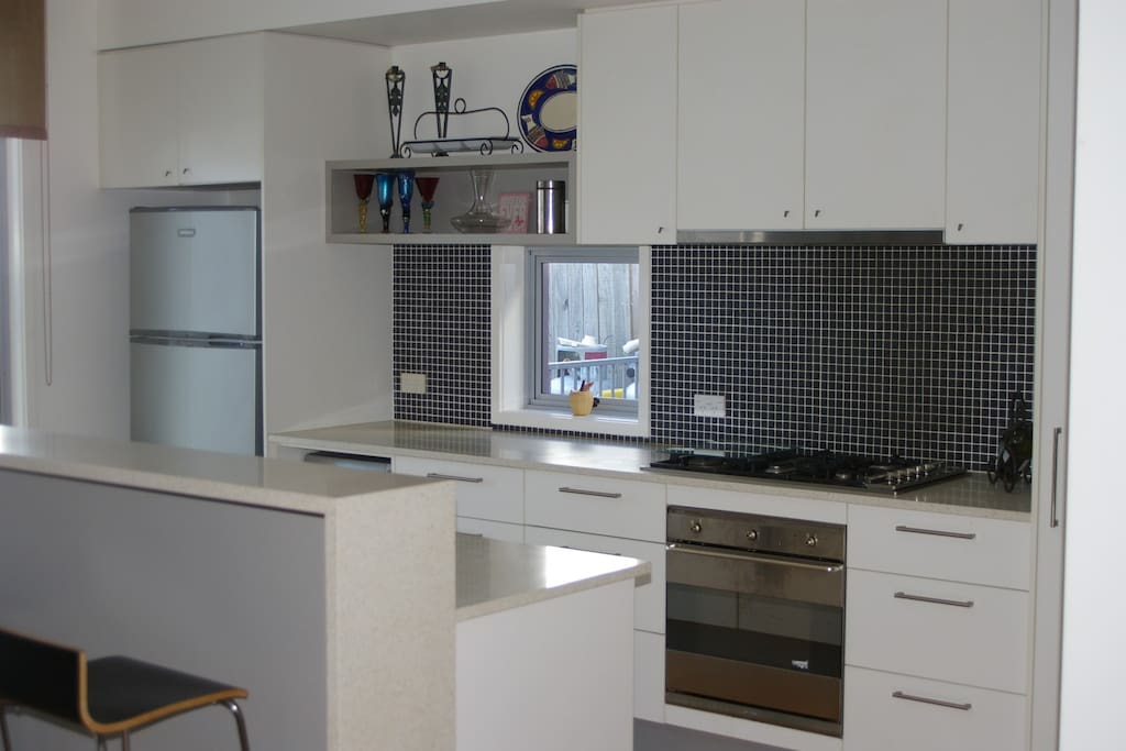 Kitchen has all the facilities to make your stay an enjoyable experience.