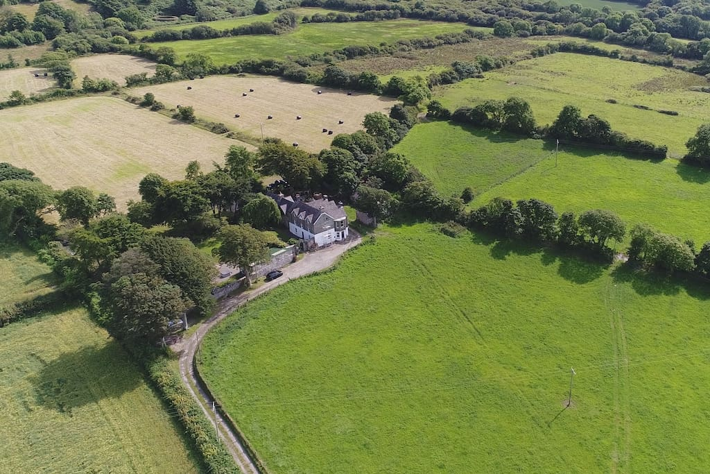 Complete privacy with beautiful surrounding farmland and views to the West of the Sea