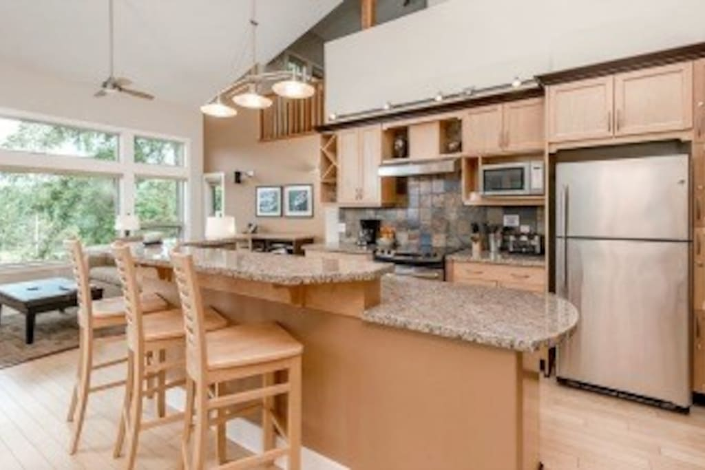 Gourmet kitchen with breakfast bar plus formal dining area