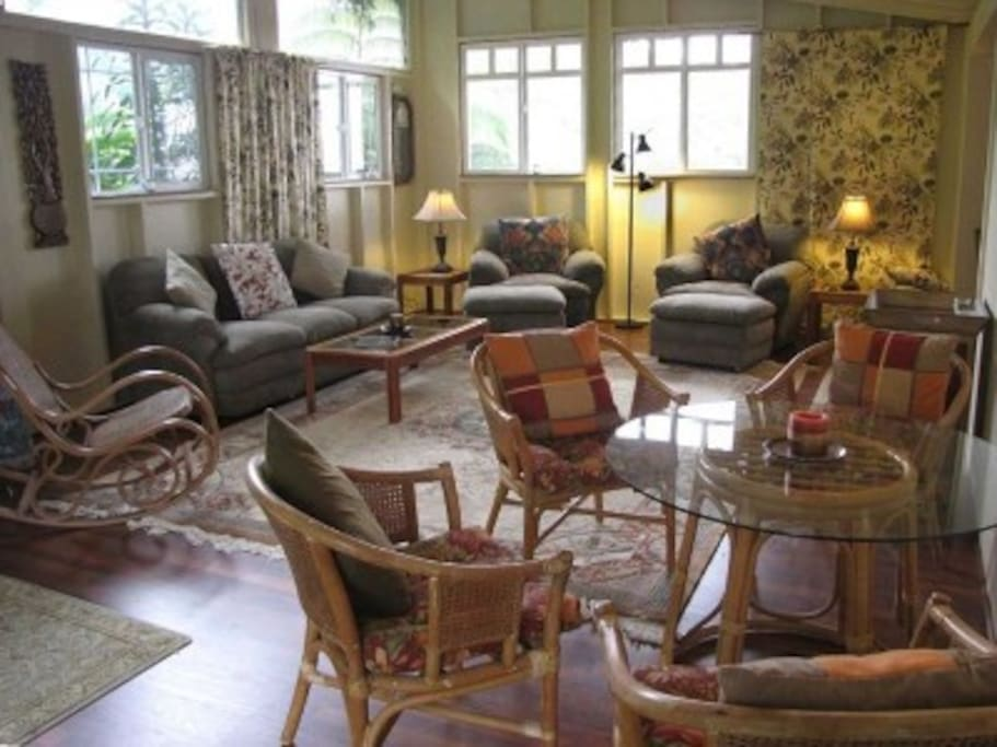 Large living room has dining nook couches, entertainment system (CD, DVD, TV), Internet WIFI.