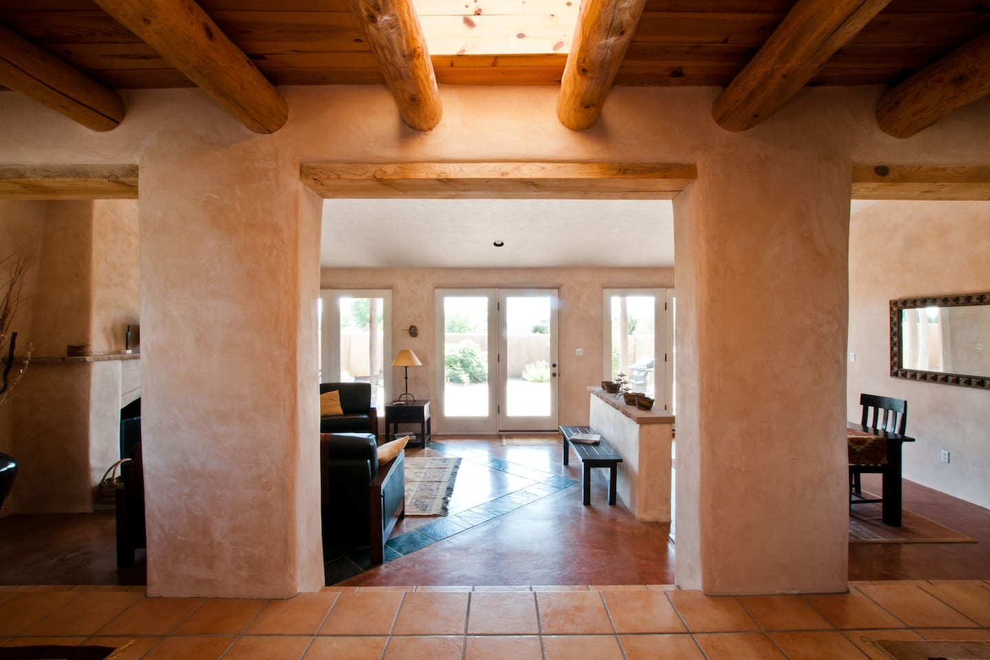 Welcome to our home. We look forward to hosting you! (entrance with view out to the Sandias)