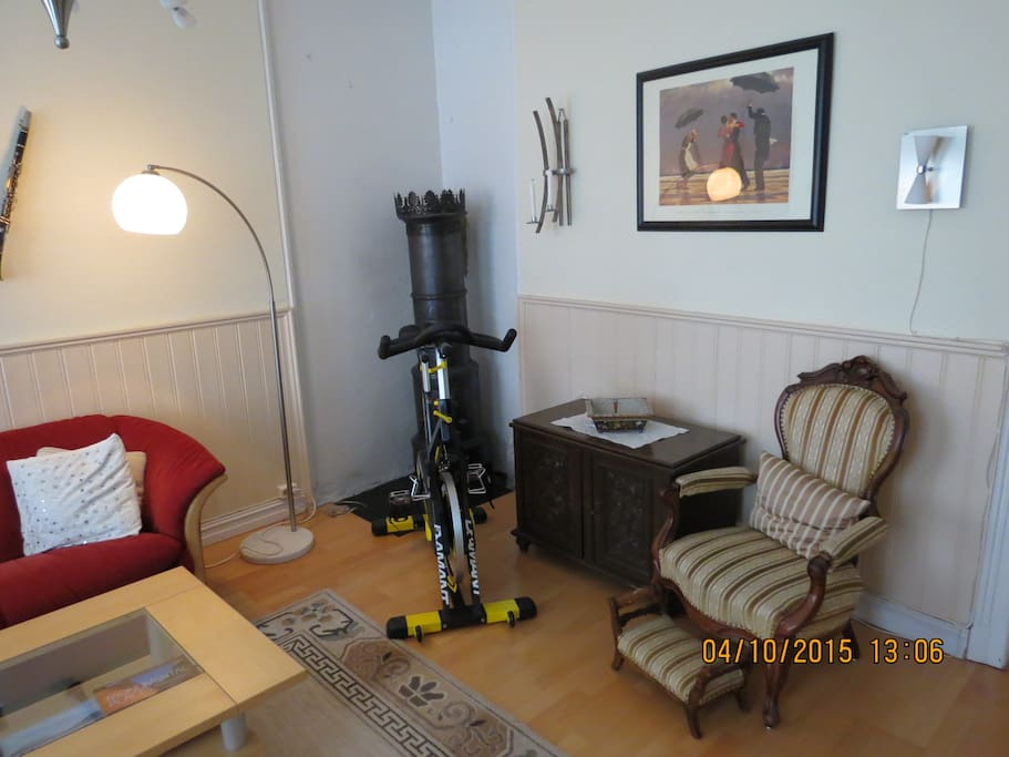 Living room has an exercise bike