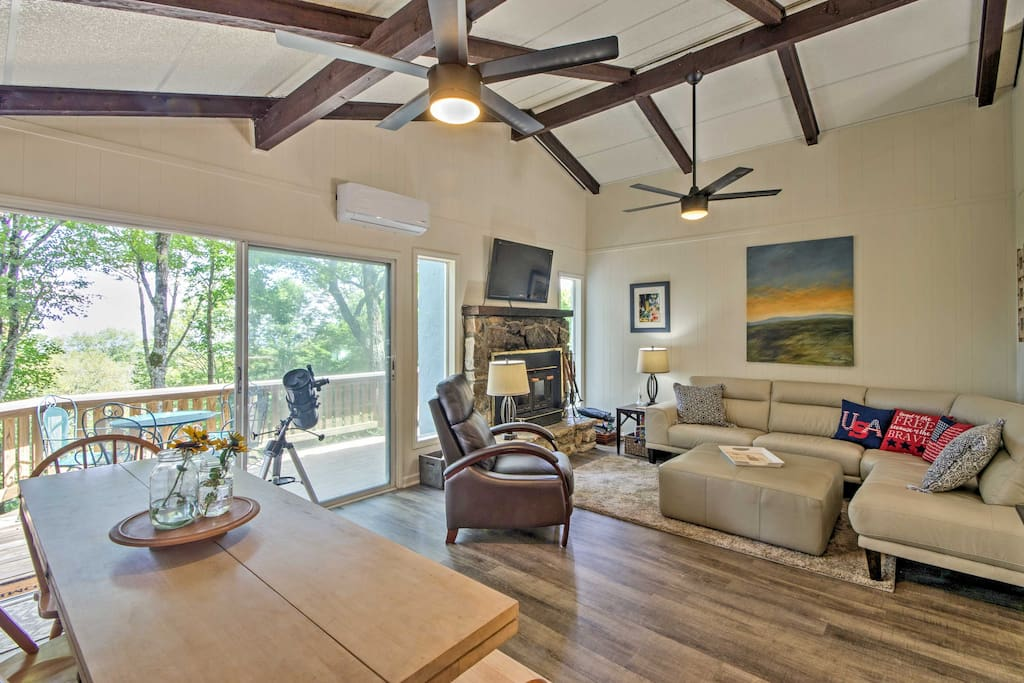 The spacious 1,200-square-foot property offers stunning views of the forest from the deck and a beautifully furnished interior for 8 lucky guests to enjoy.