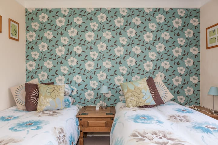 Spacious triple room, located on bus routes