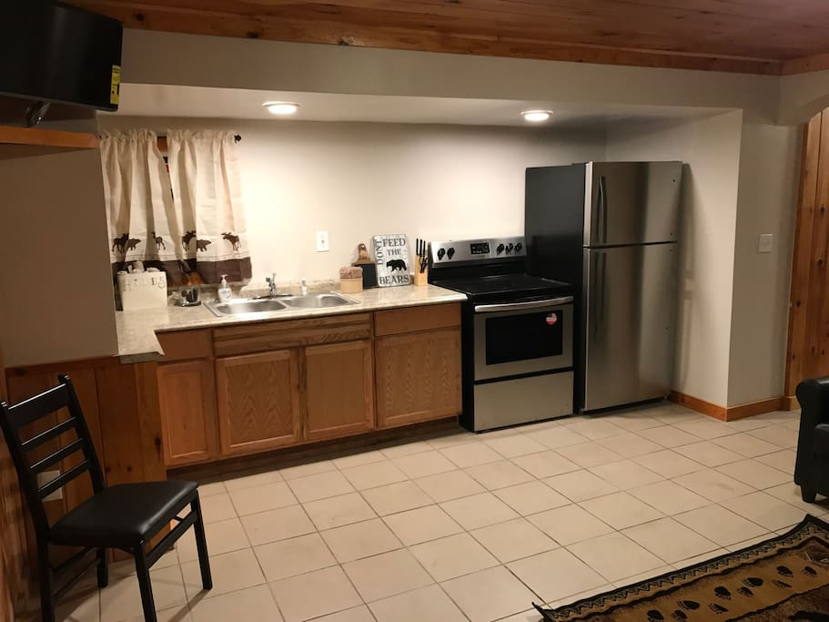 Full kitchen with stainless microwave, toaster, dinnerware for 6, cookware, full refrigerator and stove/oven combo.
