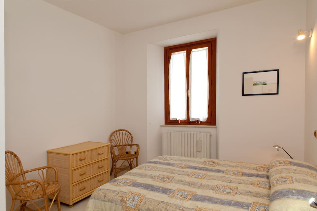 The bedroom with doublesize bed