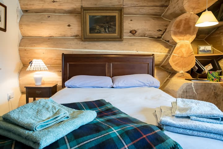 unique cosy double in traditional log house