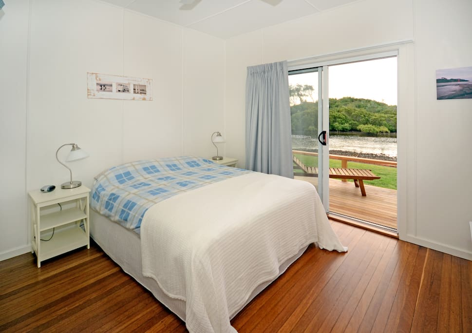 Waterfront bedroom with access to deck