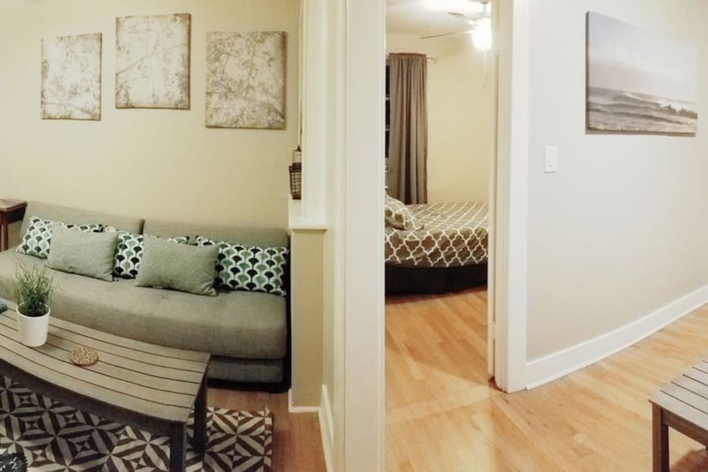 Panoramic shot of dining room living room bedroom (guest bedroom on the left of the photo)
