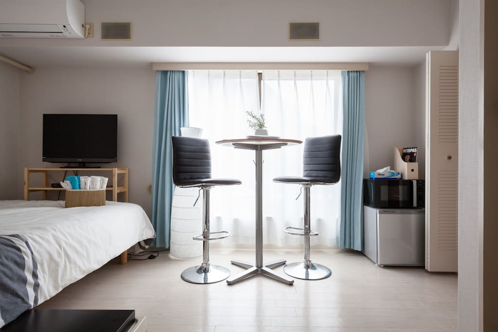 Shot of the main space - double bed with bar table