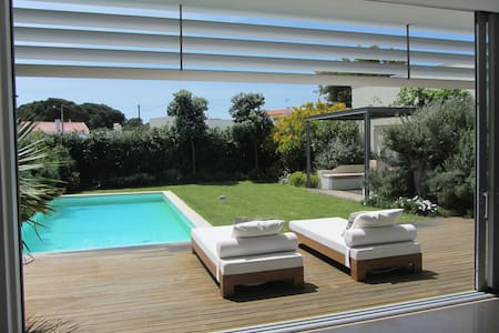 Modern villa with private swimming pool, located in a very quiet area at Aldeia do Meco, circa 1-2 km from several beaches and 35 km away from Lisbon, in a private condominium of 7 villas.  It is a perfect place for those who like beach and nature.