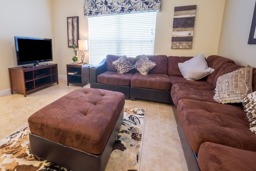 Grab some popcorn and gather around the flat screen TV to enjoy a movie together, on the comfortable sectional sofa.