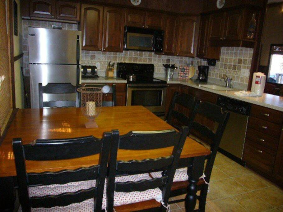 Updated kitchen with seating for six plus two additional counter spaces with bar stools.