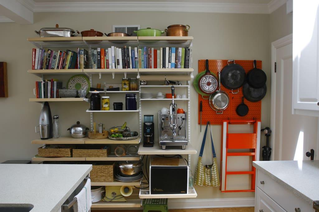 Kitchen wall unit with the espresso machine.