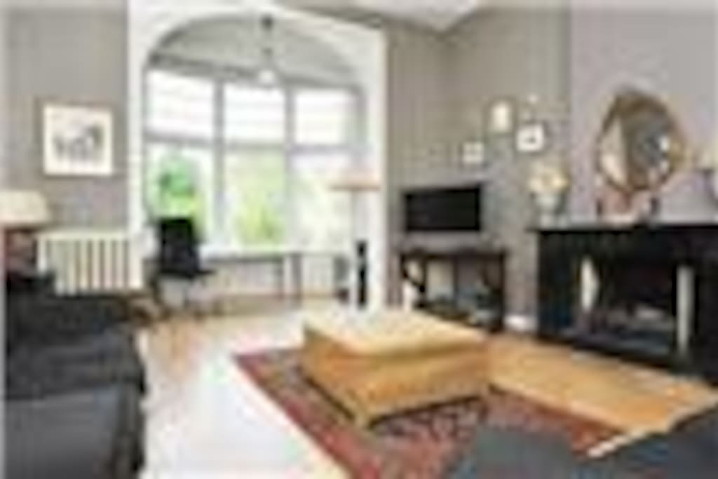 Large room with fireplace and tv, nespresso machine, water cooker etc.