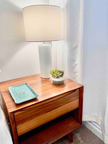 Clean bedroom with reading lamps