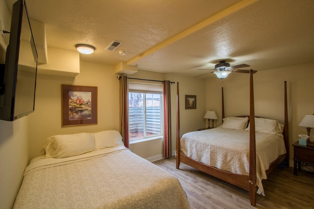 This bedroom has 2 queen beds a private bathroom