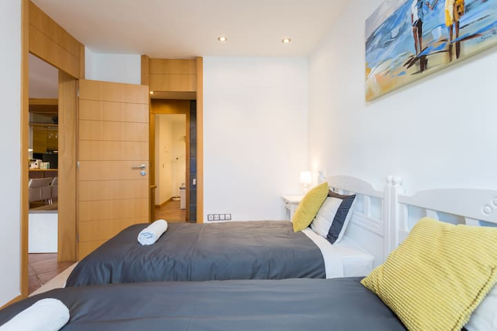 first bedroom with twin beds, can convert to double bed. nice view of the terrace and ocean