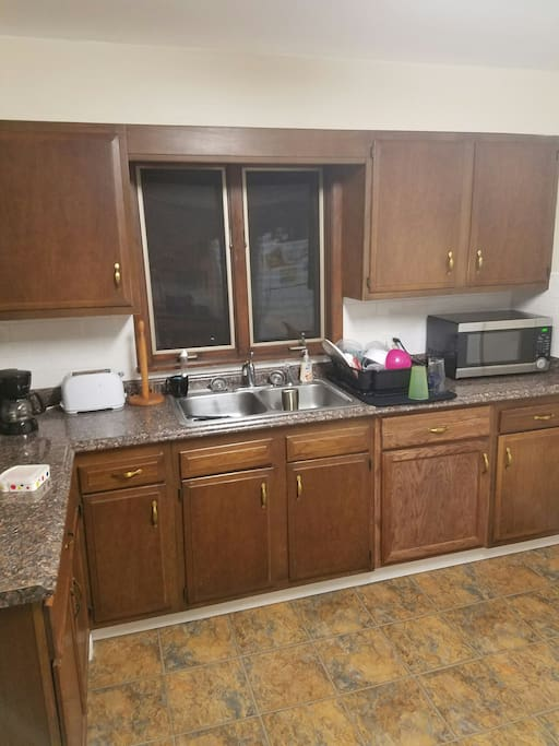 kitchen sink, coffee pot, coffee provided