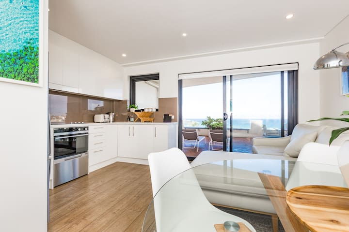A full kitchen that opens up to the living and dining area