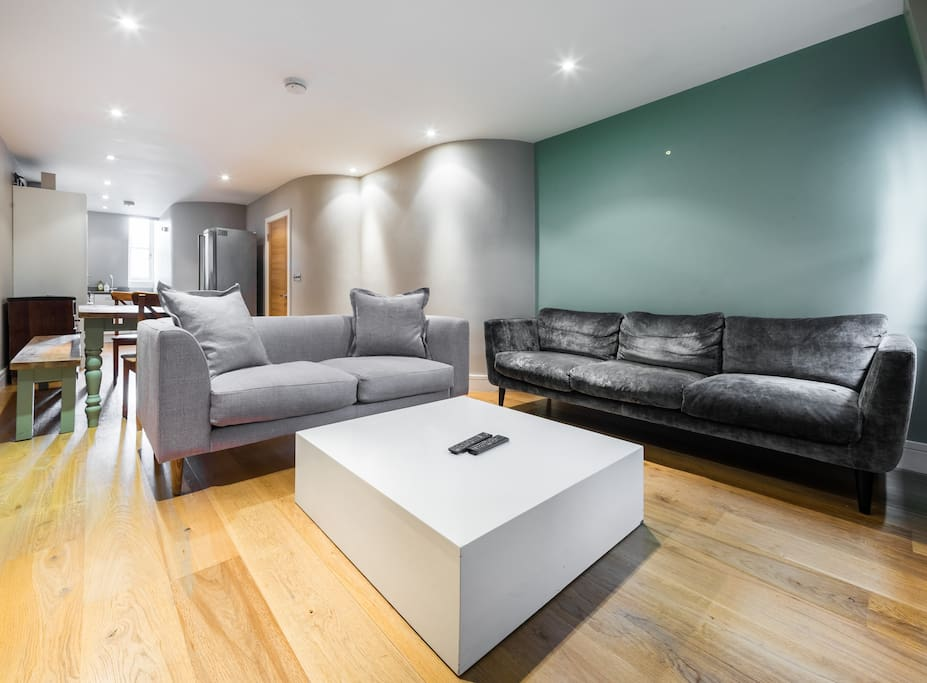 Spacious bright living area with lots of comfy seating