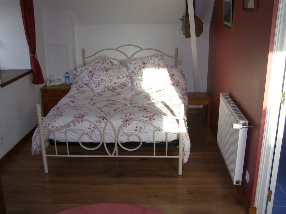 Upstairs is a large sleeping area with a double bed (pictured) and single bed. All linen provided.