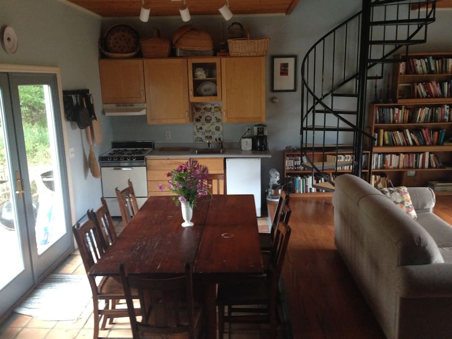 The mini-kitchen and dining area are in the front of the house. Both the front and back have double glass doors.