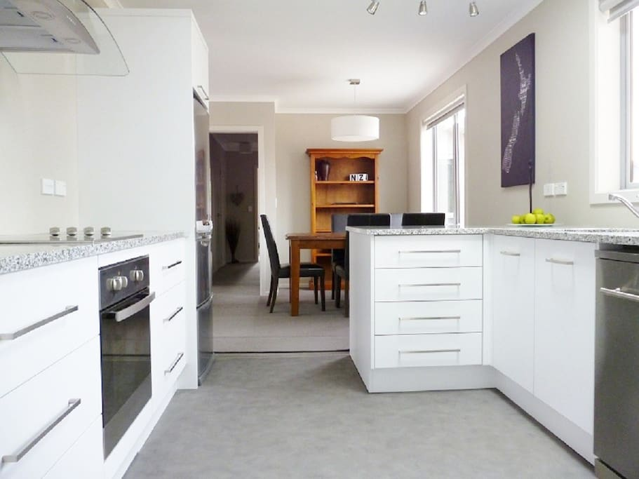 Well equipped kitchen - all essentials required for cooking and baking. Sky light, lighting, opening windows, dishwasher, microwave, oven, pantry, large fridge/freezer. Kitchen basics provided.