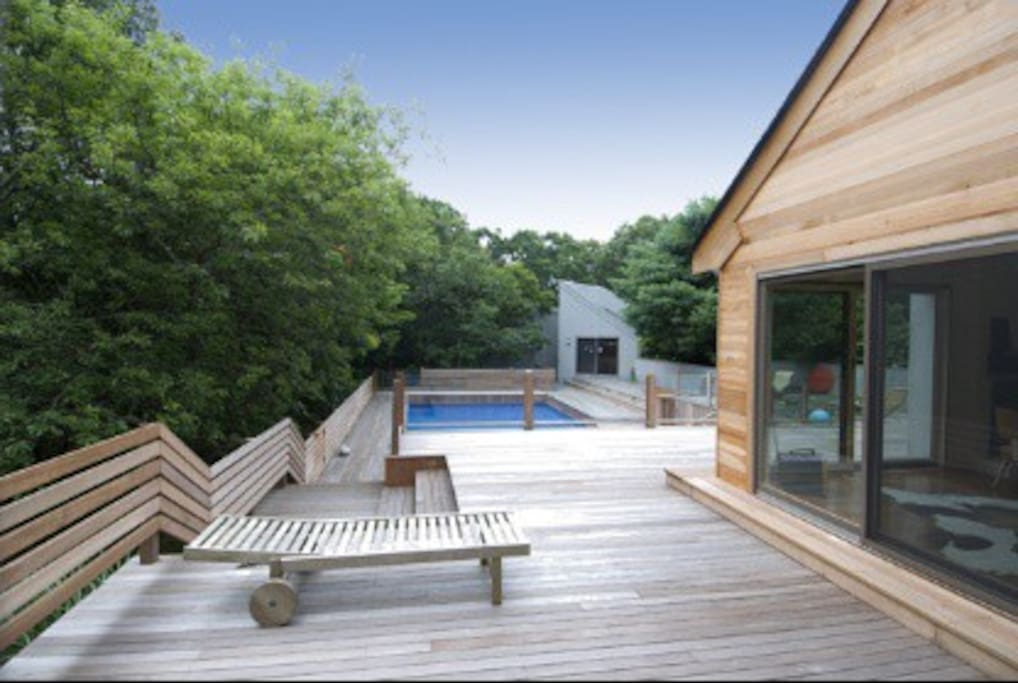 Airfield-size mahogany deck around the pool