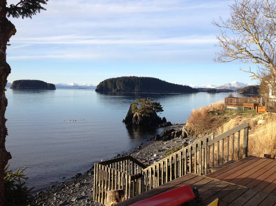 Morning views from the deck, staircase down to private 200' rocky beach, great for campfires, launching kayaks, tide pooling, and finding beach glass.