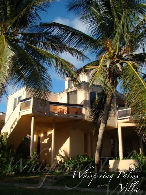 Whispering Palms Villa is located less than a minute away from the beach!