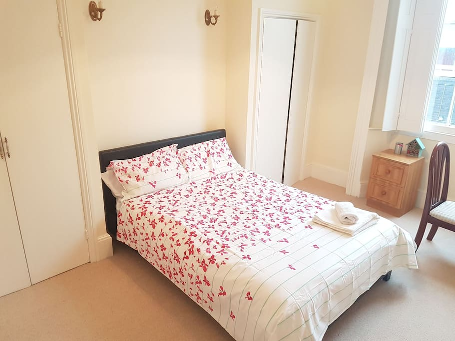 Spacious bedroom with a double bed